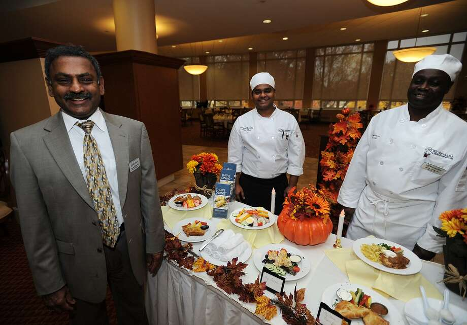 From left, Dining Services Director Pradheep Shankar, Sous Chef Sripal Reddy, and Executive Chef Michael Stevens developed the Thrive Dining menu for residents with memory loss at The Watermark at 3030 Park in Bridgeport. Thrive Dining meals are designed to be eaten without utensils but still incorporate all of the flavor, texture, and nutritional value of a traditional meal. Photo: Brian A. Pounds / Hearst Connecticut Media / Connecticut Post