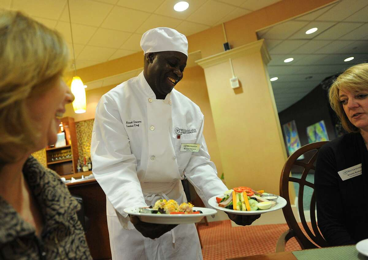 Executive Chef Michael Stevens shows examples of a Thrive Dining chef salad next to a traditional chef salad to Sales Director Ann Serti, left, and Executive Director Kristin Butler at The Watermark at 3030 Park in Bridgeport, Conn. on Wednesday, November 9, 2016. Thrive Dining meals are designed for residents with memory loss issues to be eaten without utensils but still incorporate all of the flavor, texture, and nutritional value of a traditional meal.