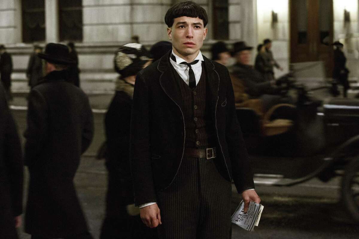 """This image released by Warner Bros. Entertainment shows Ezra Miller in a scene from, """"Fantastic Beasts and Where to Find Them."""" (Jaap Buitendijk/Warner Bros. via AP)"""