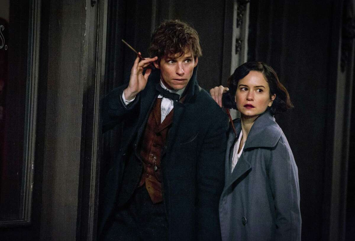 """This image released by Warner Bros. Entertainment shows Eddie Redmayne, left, and Katherine Waterston in a scene from, """"Fantastic Beasts and Where to Find Them."""" (Jaap Buitendijk/Warner Bros. via AP)"""