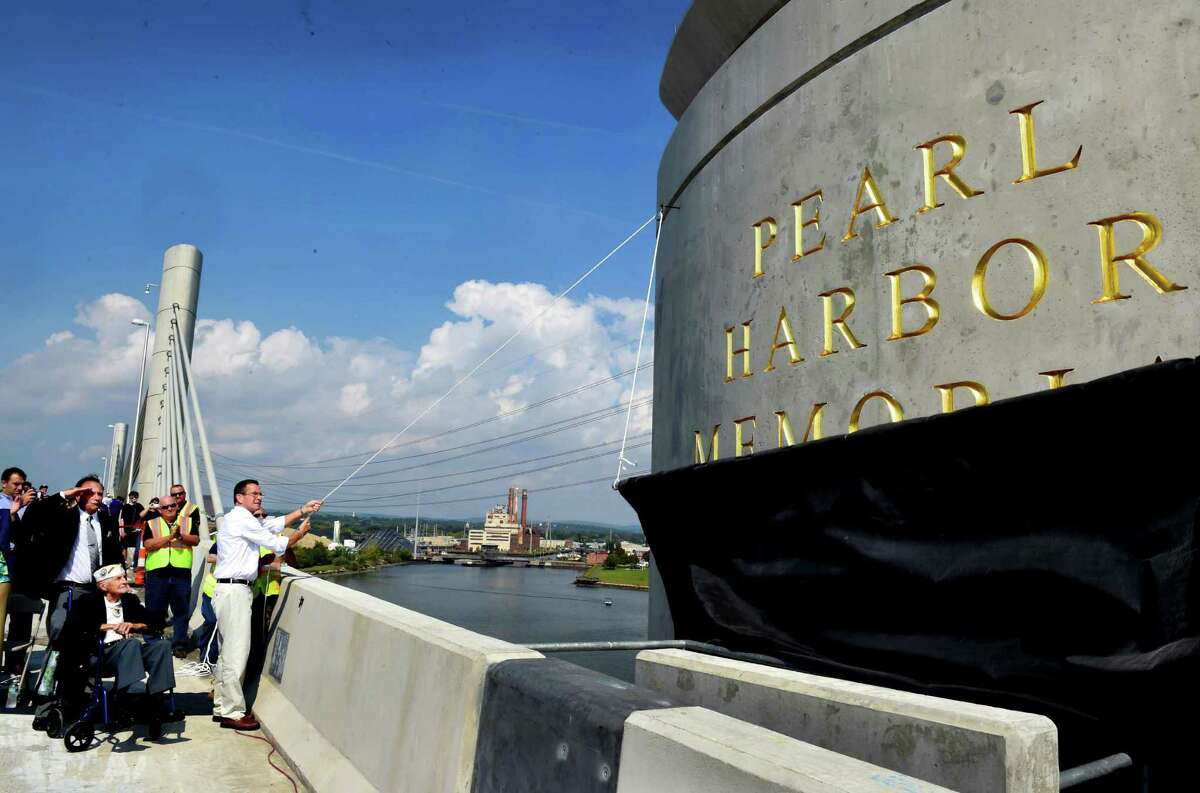 The new Pearl Harbor Memorial Bridge is unveiled on Interstate 95 during its grand opening celebration Saturday, Sept. 19, 2015, in New Haven, Conn. The bridge is a key part of an 18-year, nearly $2 billion I-95 improvement program in the New Haven Harbor area. (Peter Hvizdak/New Haven Register via AP) MANDATORY CREDIT