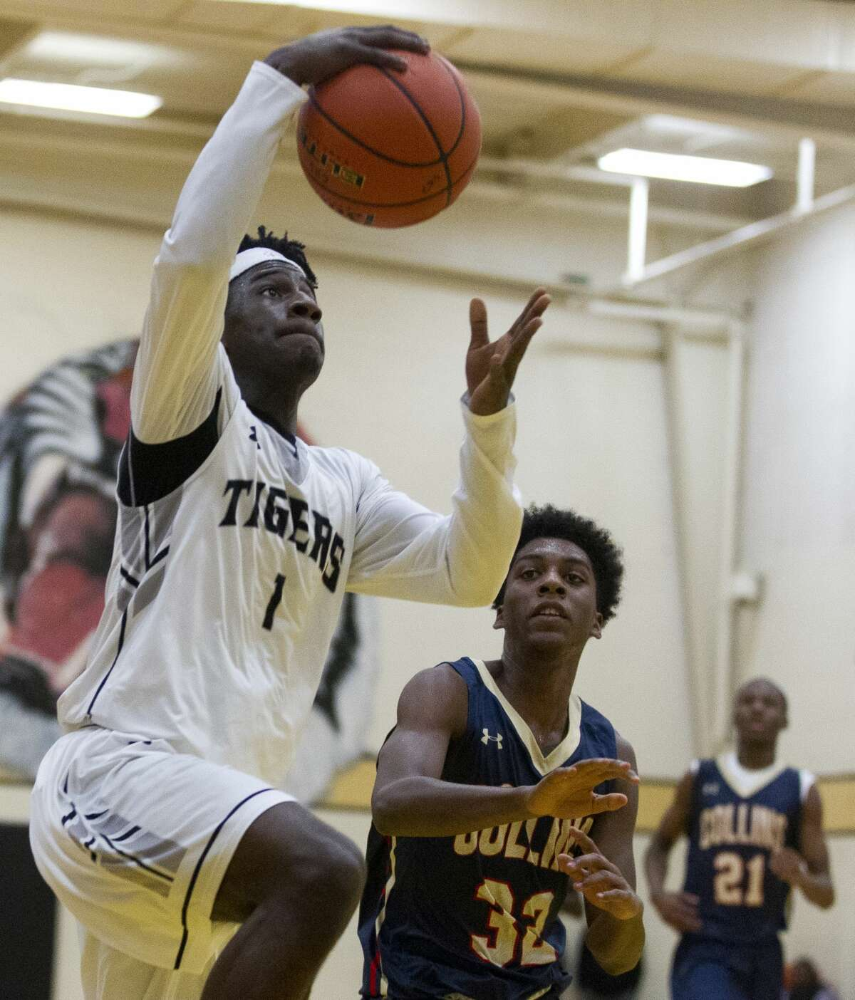 Conroe point guard Jay Lewis (1) gets past Klein Collins point guard Patrick Harris (32) during the second quarter of a non-district high school boys basketball game at Conroe High School Tuesday, Nov. 15, 2016, in Conroe.