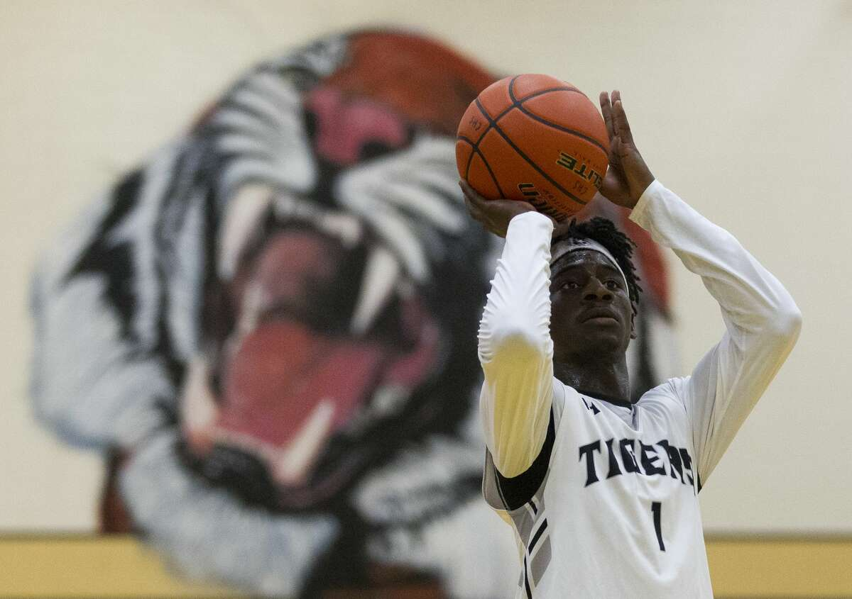 Conroe point guard Jay Lewis (1) shoots a free throw during the second quarter of a non-district high school boys basketball game at Conroe High School Tuesday, Nov. 15, 2016, in Conroe.