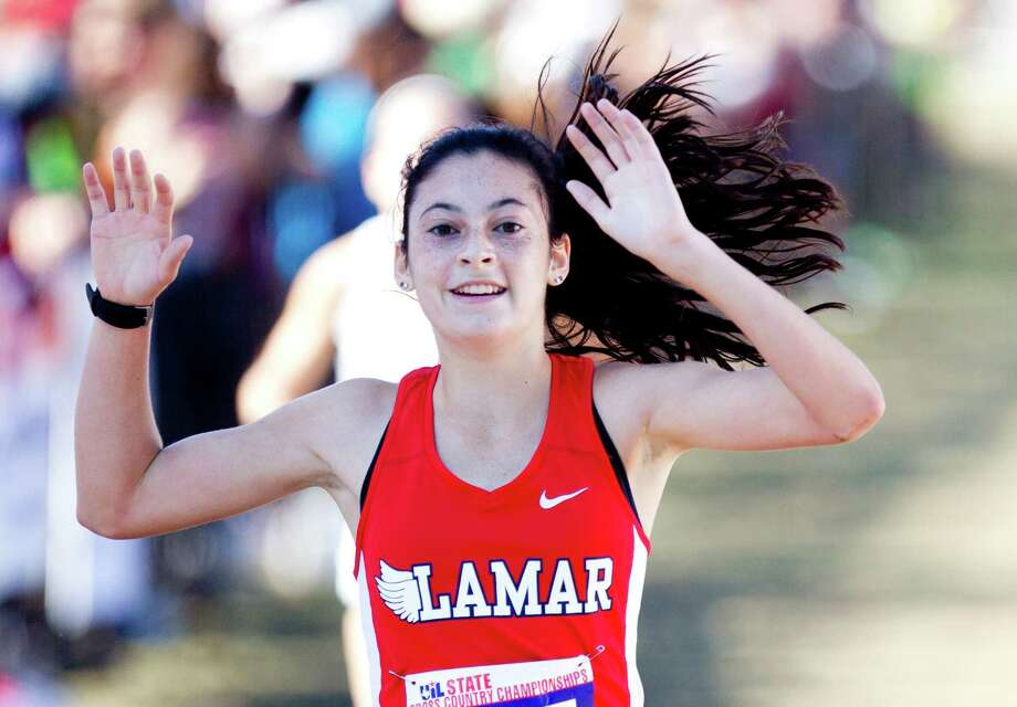 Julia Heymach, of Lamar, celebrates after defending her Class 6A varsity girls state title during the UIL state cross country championships at Old Settlers Park Saturday, Nov. 12, in Round Rock. Photo: Jason Fochtman, Staff Photographer / Houston Chronicle