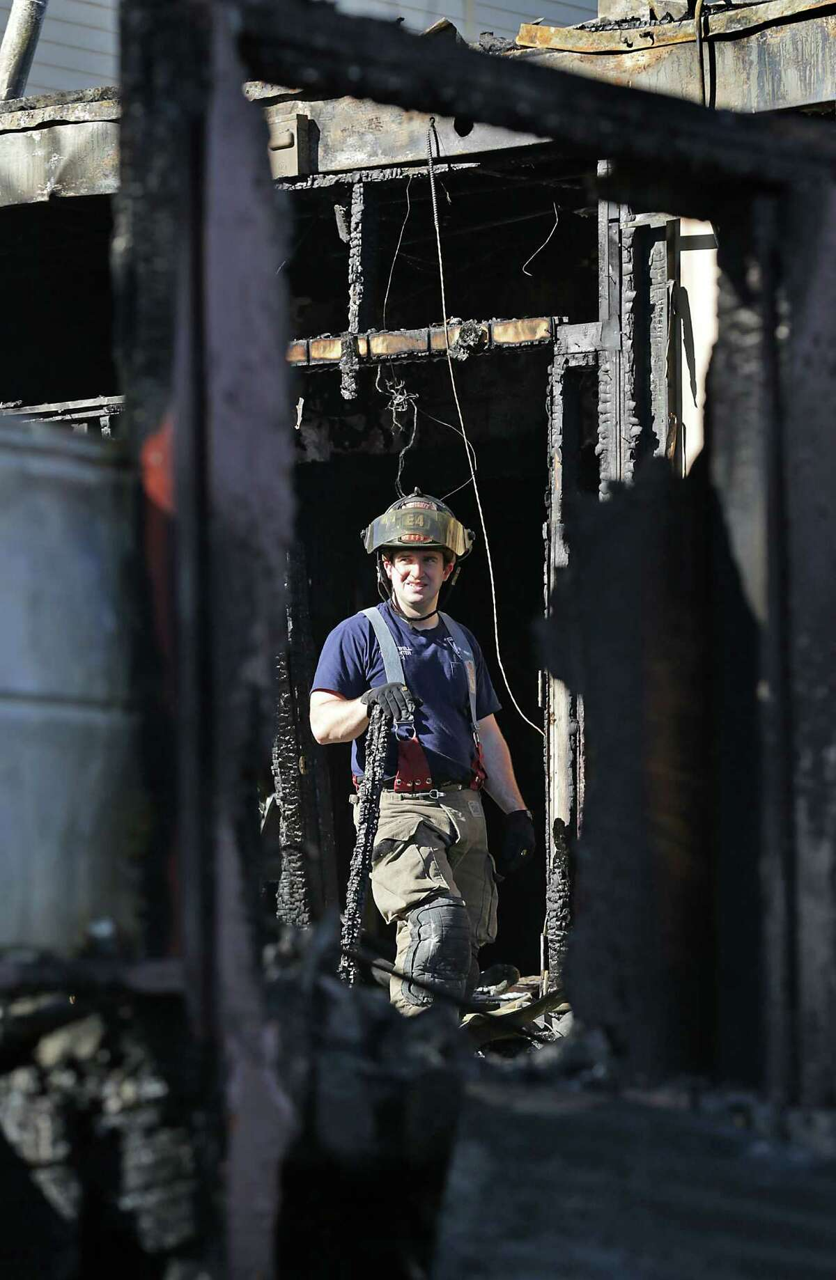 A San Antonio fire fighter looks over the damage after fire broke out early Wednesday morning, Nov. 16, 2016, at The Phantom Room on N. St. Mary's St.