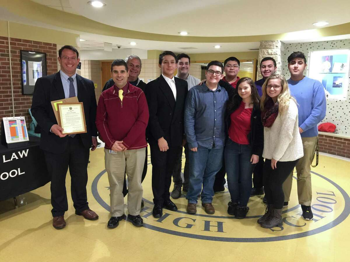 Members of the Law High Key Club, along with Principal Fran Thompson and Ted Boynton, JLHS Key Club Advisor, welcome Mayor Benjamin Blake before he delivers a City Proclamation announcing Key Club Week in Milford.