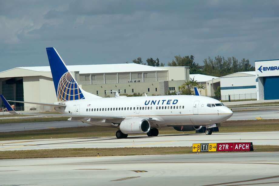 """(FILES) This file photo taken on February 21, 2013 shows  A United Airlines jet takes off from  Fort Lauderdale-Hollywood International Airport in Ft. Lauderdale, Florida.  United Airlines on November 15, 2016 said it will offer a new """"Basic Economy"""" fare. In exchange for the discount, these travelers will get assigned seats on the day they fly and will be allowed one carry-on that must fit under their seats. They'll get food, beverage and Wi-Fi service. The new fares will go on sale in January for flights starting after March, a spokesperson said. / AFP PHOTO / KAREN BLEIERKAREN BLEIER/AFP/Getty Images Photo: KAREN BLEIER, AFP/Getty Images"""