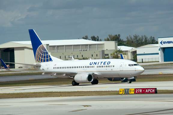 """(FILES) This file photo taken on February 21, 2013 shows  A United Airlines jet takes off from  Fort Lauderdale-Hollywood International Airport in Ft. Lauderdale, Florida.  United Airlines on November 15, 2016 said it will offer a new """"Basic Economy"""" fare. In exchange for the discount, these travelers will get assigned seats on the day they fly and will be allowed one carry-on that must fit under their seats. They'll get food, beverage and Wi-Fi service. The new fares will go on sale in January for flights starting after March, a spokesperson said. / AFP PHOTO / KAREN BLEIERKAREN BLEIER/AFP/Getty Images"""