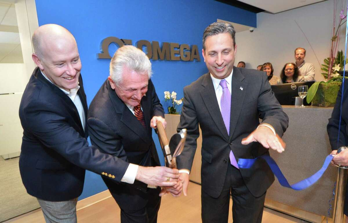 Omega Engineering President Joe Vorih cuts the ribbon on their new space at Riverpark on Connecticut Ave. with help from Norwalk Mayor Harry Rilling and State Senator Bob Duff during an opening reception for its new headquarters on Tuesday November 15 2016 in Norwalk Conn.