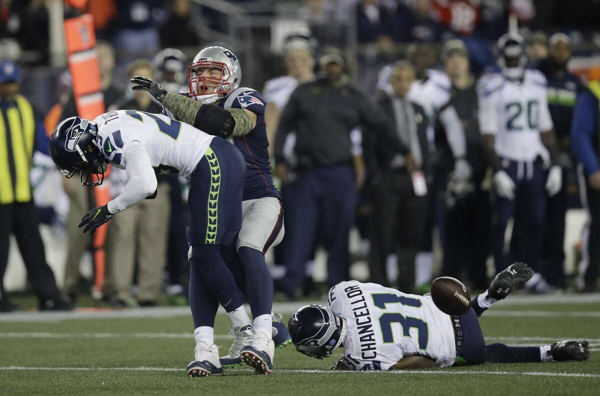 Seattle Seahawks safety Earl Thomas, left, breaks up a pass intended for New England Patriots tight end Rob Gronkowski as Seahawks safety Kam Chancellor pursues during the first half of an NFL football game, Sunday, Nov. 13, 2016, in Foxborough, Mass. (AP Photo/Charles Krupa)