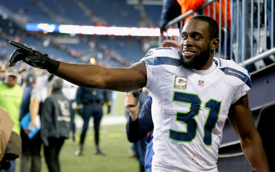 Kam Chancellor of the Seattle Seahawks reacts following a game against the New England Patriots during a game at Gillette Stadium on November 13, 2016 in Foxboro, Massachusetts.  (Photo by Jim Rogash/Getty Images) Photo: Jim Rogash/Getty Images