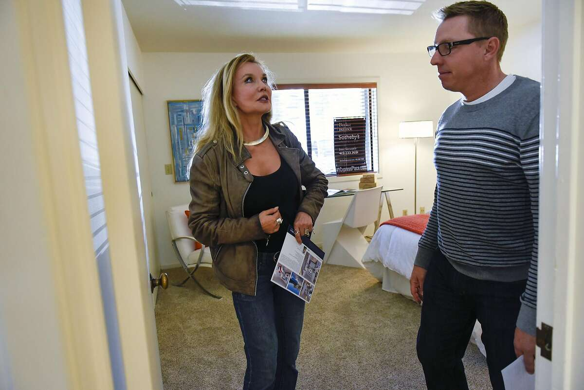 Potential buyer Monique Dahlquist is shown around by her broker Jason Holmes with Holmes Burrell Real Estate during a broker's open house hosted by realtor Joan Kermath of Sotheby's International Reality, in Sausalito, CA Wednesday, November 16, 2016.