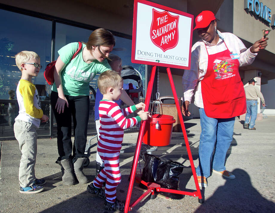 Kathy Williams rings a bell for the Salvation Army on Dec. 1 outside Hobby Lobby on Loop 250.  Photo: BY JAMES  DURBIN