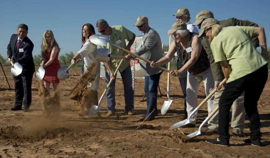 Community leaders join together June 29 to break ground for The Way Retreat Center. Photo: BY TIM  FISCHER