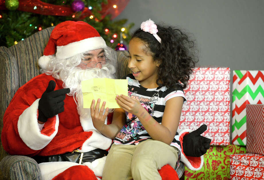 Perys Hodge, 10, shares her Christmas list with Santa during a Centers for Children and Families Christmas party on Dec. 9 at the Junior League of Midland. Photo: BY JAMES DURBIN