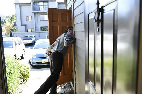 Broker Steve Sekhon of McGuire Real Estate peeks into a storage space  during a broker's open house for a condo hosted by Joan Kermath of Sotheby's International Reality, in Sausalito, CA Wednesday, November 16, 2016.