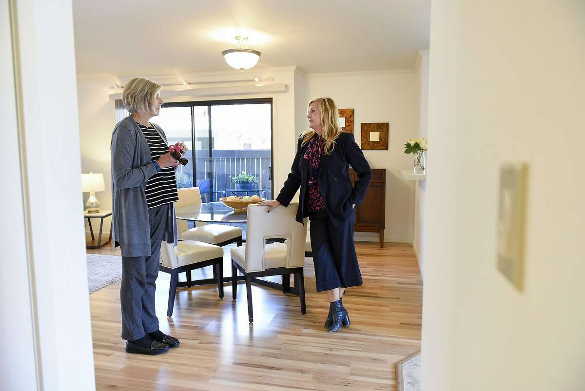 Realtor Joan Kermath of Sotheby's International Reality, right, speaks with broker Lynn Reid of McGuire Real Estate, during a broker's open house for a condo in Sausalito, CA Wednesday, November 16, 2016.