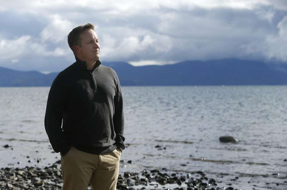 Sierra Watch executive director Tom Mooers walks along the Lake Tahoe shoreline in Tahoe City, Calif. on Wednesday, Nov. 16, 2016. The Placer County Board of Supervisors approved an ambitious expansion plan at the nearby Squaw Valley ski resort which is opposed by Mooers group. Photo: Paul Chinn, The Chronicle