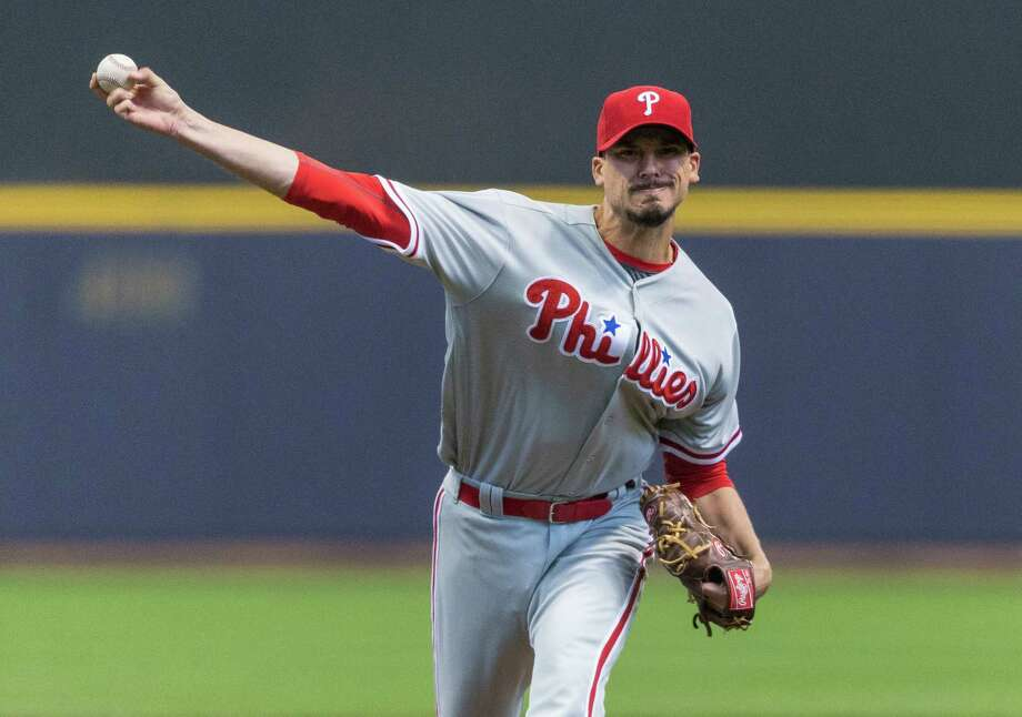 FILE - In this April 23, 2016, file photo. then-Philadelphia Phillies' Charlie Morton pitches to a Milwaukee Brewers batter during the first inning of a baseball game, in Milwaukee. Charlie Morton agreed to a contract with Houston on Wednesday, Nov. 16, 2016, giving the Astros two of the best groundball pitchers in the majors.(AP Photo/Tom Lynn, File) Photo: Tom Lynn, FRE / FR170717 AP