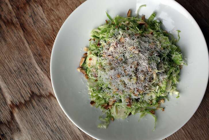 Shaved brussel sprout salad with dill and cheese by Molly Watson in San Francisco, Calif., on Thursday, October 30, 2014.
