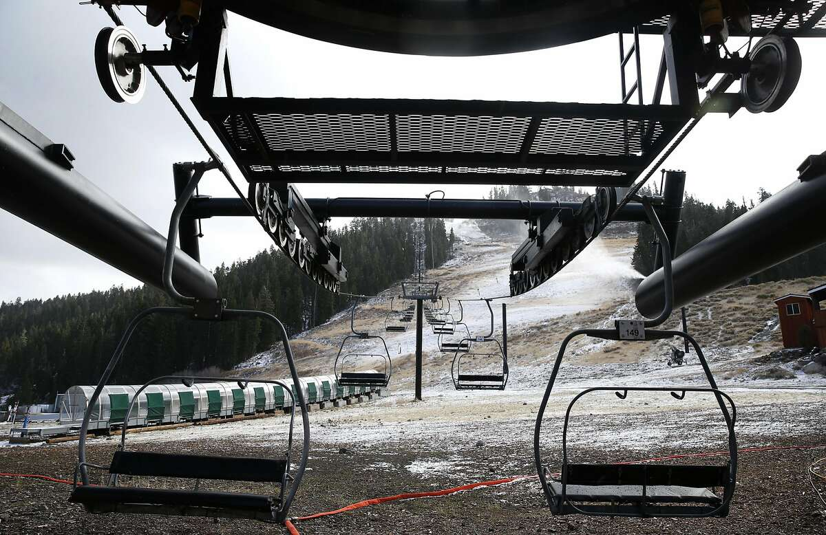 Snow making equipment begins covering the lower portion of the Red Dog ski run in Squaw Valley, Calif. on Wednesday, Nov. 16, 2016. The Placer County Board of Supervisors approved an ambitious expansion plan at the Squaw Valley ski resort.