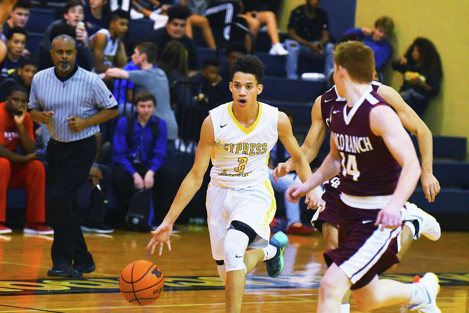 Cy Ranch senior guard Reggie Mitchell drives against Cinco Ranch in the second half of Tuesday's 64-55 loss. Mitchell was an absolute dynamo in the contest, scoring 15 points on 50 percent shooting and making plays all over the court. Photo: Tony Gaines / HCN