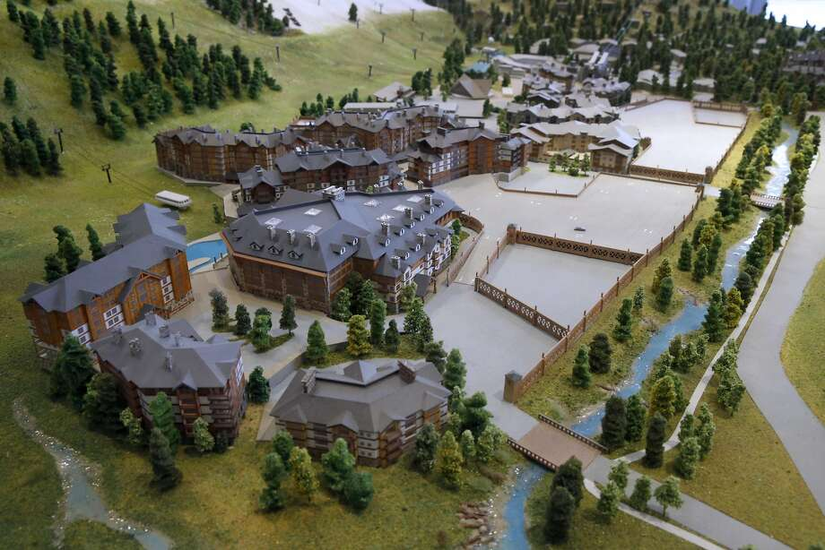 A scale model depicts a large development (foreground, with dark gray roofs) planned for the current parking area at Squaw Valley. Photo: Paul Chinn, The Chronicle