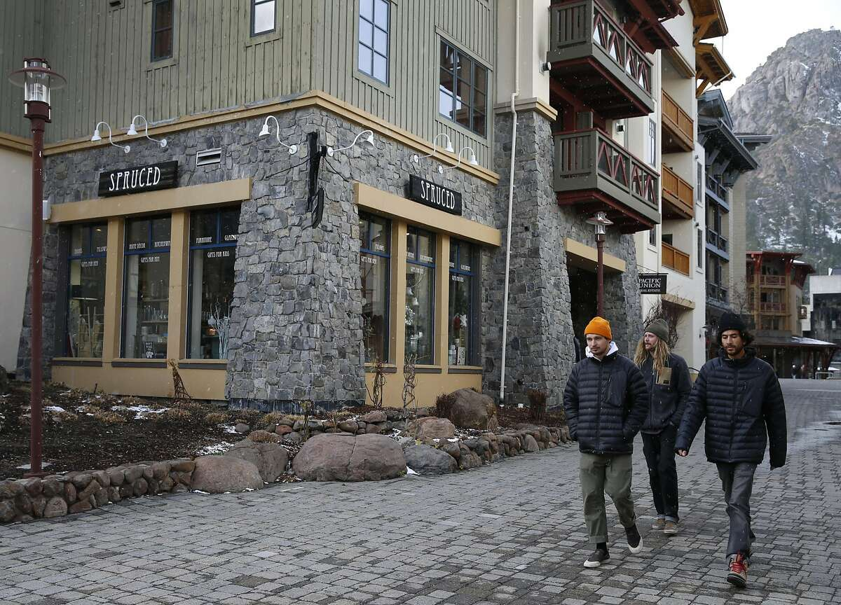 Visitors walk through the village at Squaw Valley, Calif. on Wednesday, Nov. 16, 2016. The Placer County Board of Supervisors approved an ambitious expansion plan at the Squaw Valley ski resort.