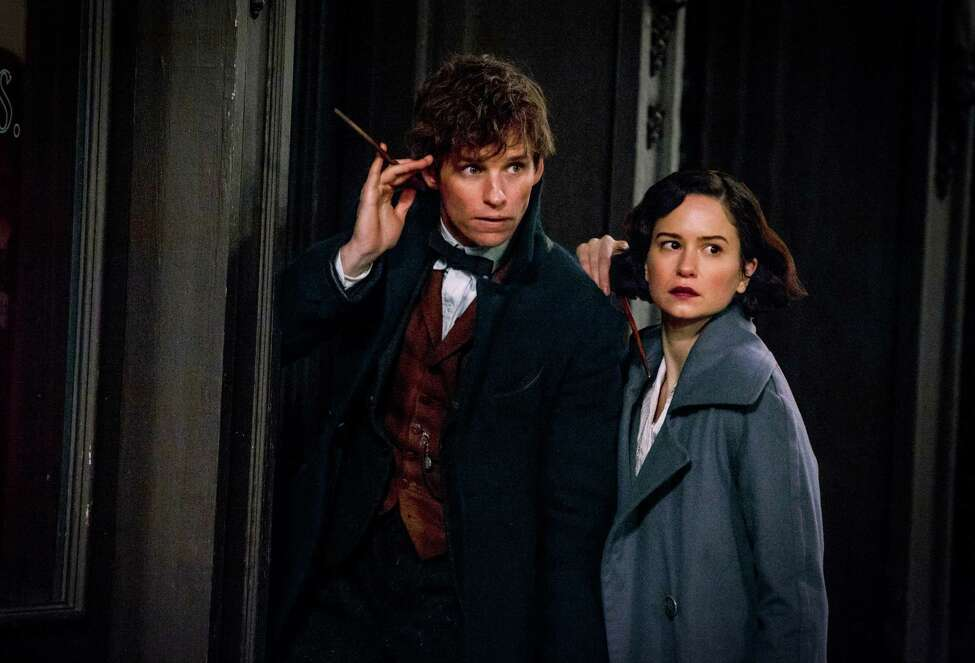 This image released by Warner Bros. Entertainment shows Eddie Redmayne, left, and Katherine Waterston in a scene from,