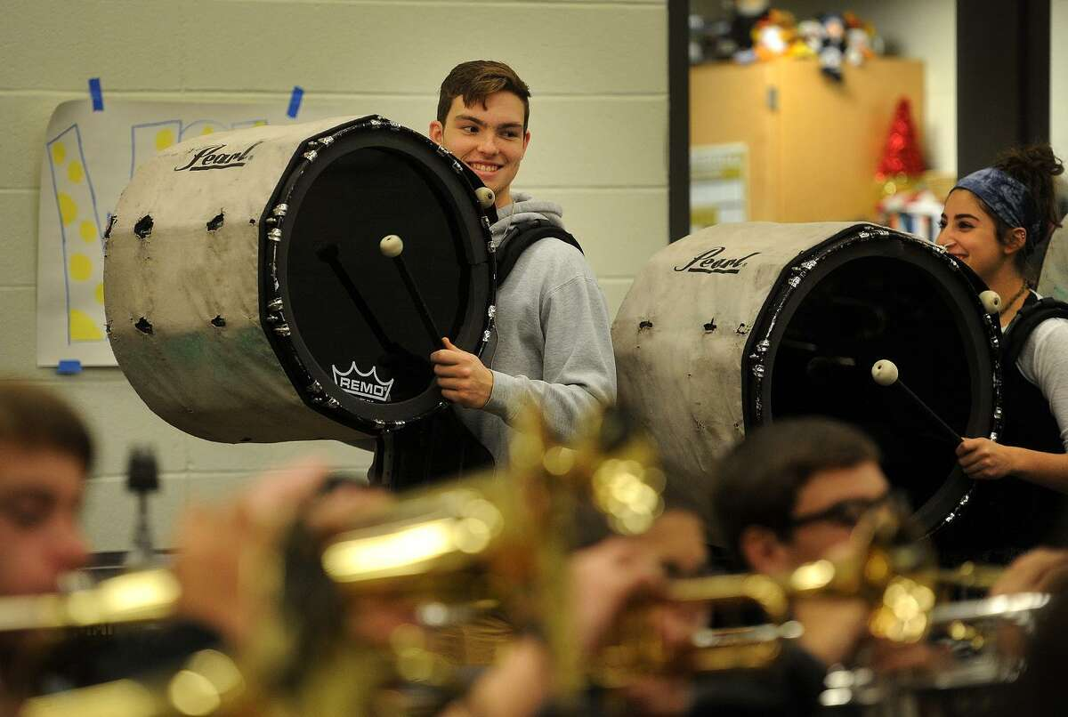 Bass drummers Jack Duda, left, and Madison Touri rehearse with the Trumbull High School Marching Band for their upcoming performance in the Stamford Thanksgiving Day Parade at the school in Trumbull, Conn. on Wednesday, November 16, 2016. The band won the U.S. Bands Class 6 Open National band competition last Saturday, November 12, at Met Life Stadium in New Jersey.