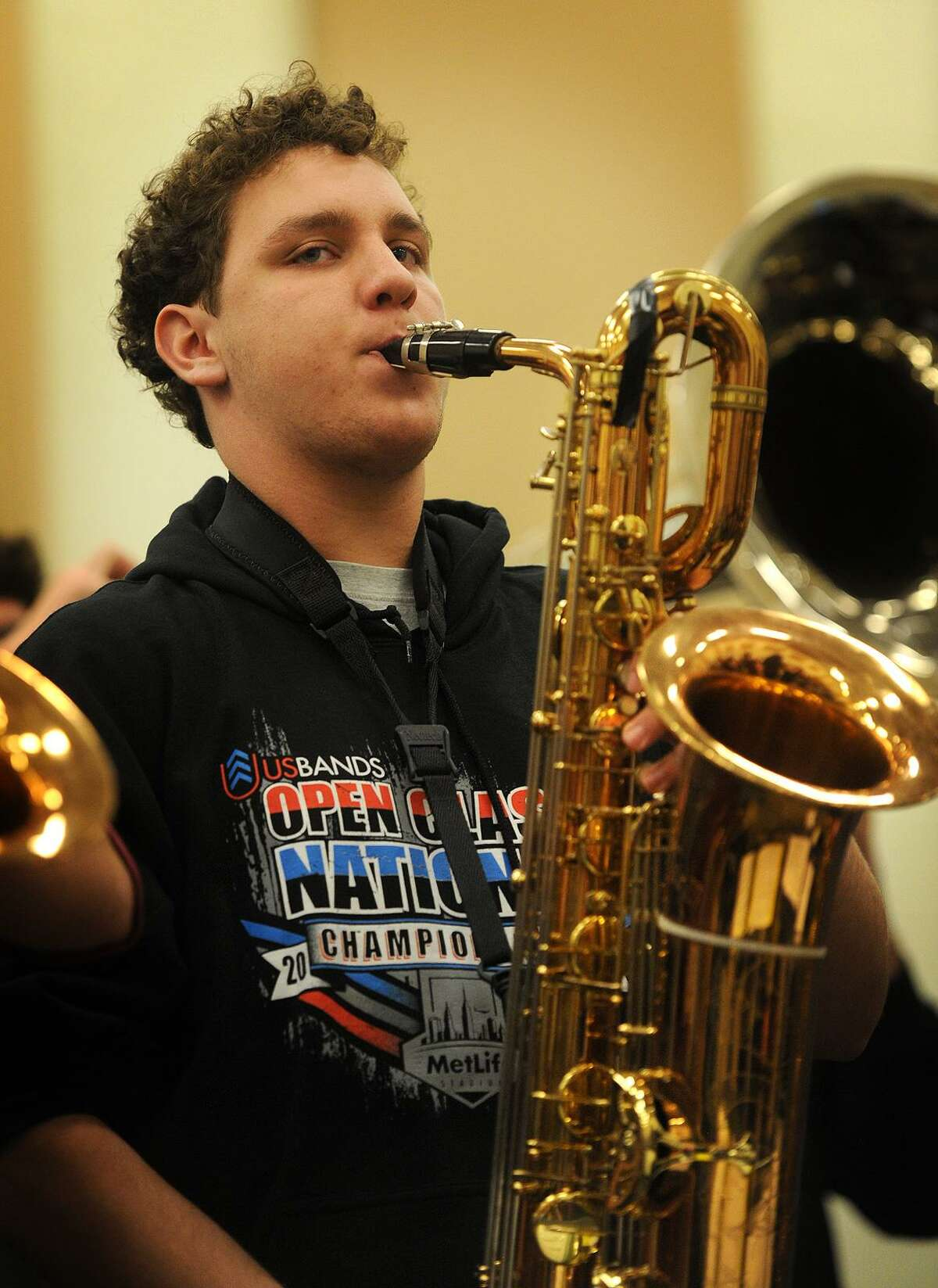 Baritone saxophone player Owen Hallock, 16, rehearses with the Trumbull High School Marching Band for their upcoming performance in the Stamford Thanksgiving Day Parade at the school in Trumbull, Conn. on Wednesday, November 16, 2016. The band won the U.S. Bands Class 6 Open National band competition last Saturday, November 12, at Met Life Stadium in New Jersey.