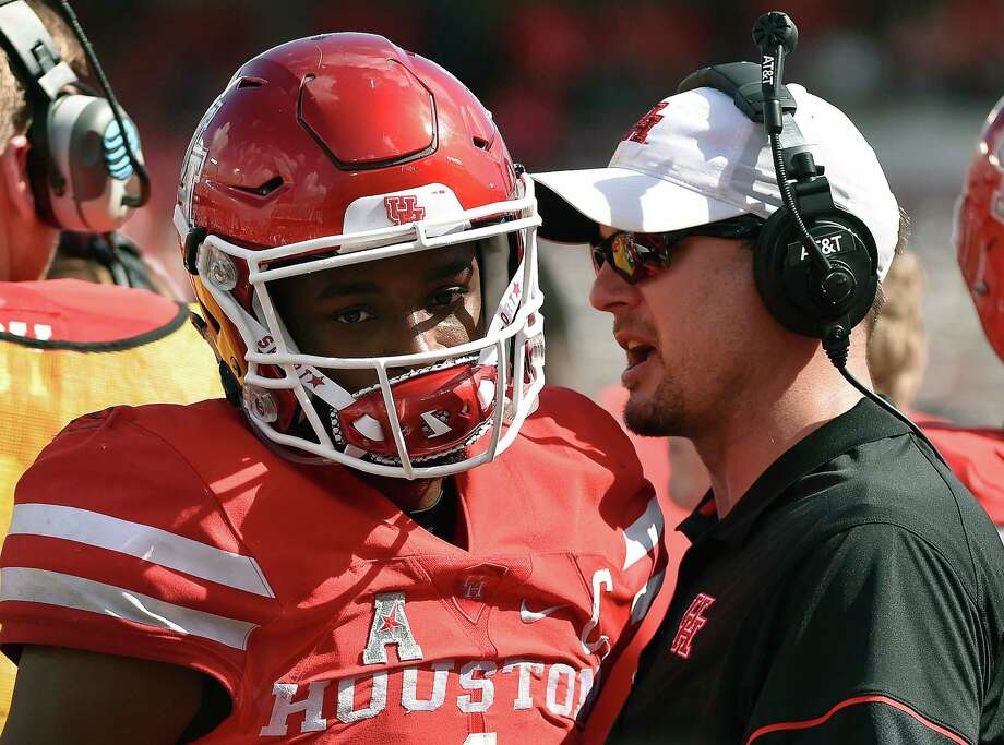 FILE - In this Oct. 29, 2016, file photo, Houston head coach Tom Herman, right, talks with quarterback Greg Ward Jr. after Ward threw his third interception of the game during the first half of an NCAA college football game against Central Florida, in Houston. No. 3 Louisville (9-1) is in the hunt for a spot in the College Football Playoff as the Cardinals prepare to face Houston (8-2) on Thursday night, Nov. 17. (AP Photo/Eric Christian Smith, File) Photo: Eric Christian Smith, FRE / FR171023 AP