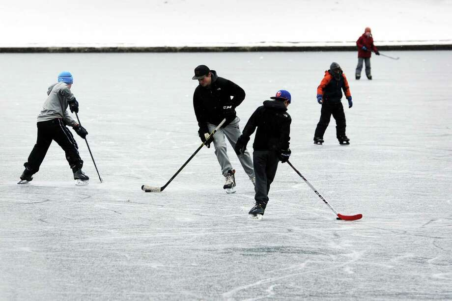 Kids skate and play hockey on Brewsters Pond in Stratford, Conn. last February. The Town of Stratford will build a temporary ice rink in nearby Longbrook Park this winter. Photo: Ned Gerard / Hearst Connecticut Media / Connecticut Post