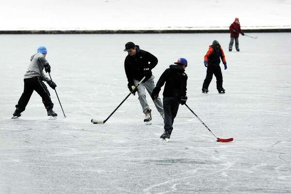 Kids skate and play hockey on Brewsters Pond in Stratford, Conn. last February. The Town of Stratford will build a temporary ice rink in nearby Longbrook Park this winter.