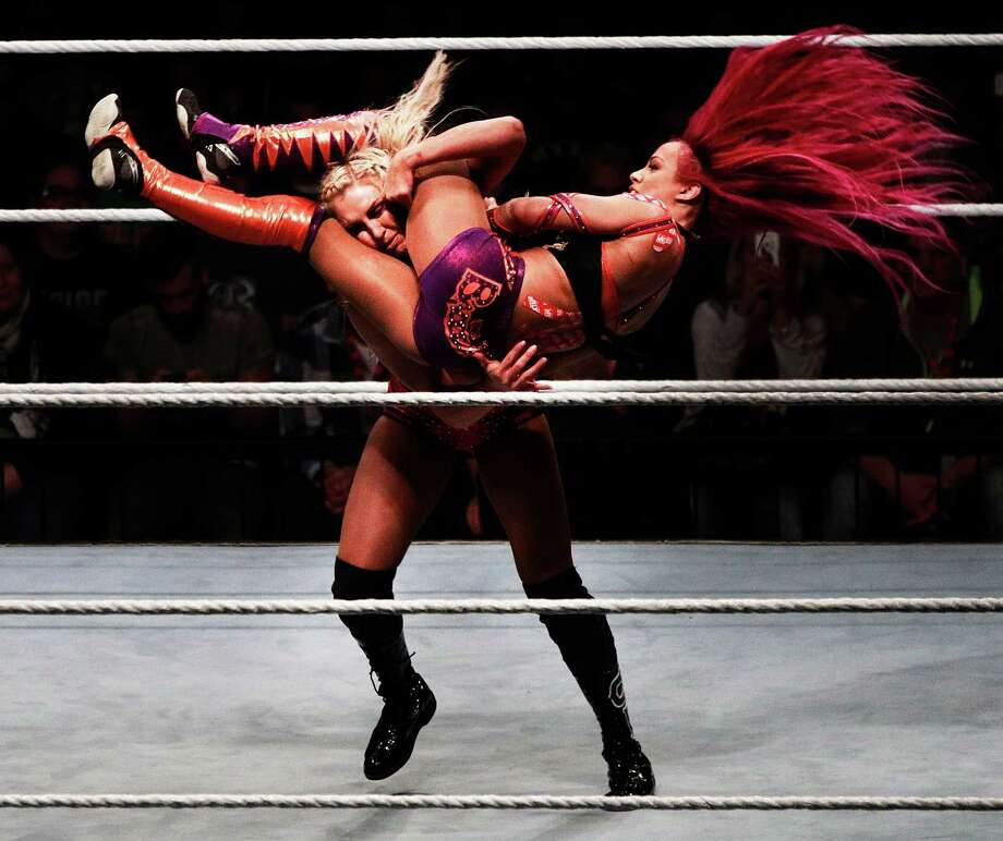 MUNICH, GERMANY - NOVEMBER 03:  Charlotte Flair takes down Sascha Banks in their match during the WWE Live Munich event at Olympiahalle on November 3, 2016 in Munich, Germany. Photo: Adam Pretty, Bongarts/Getty Images / 2016 Getty Images