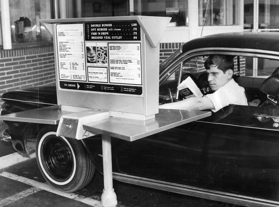 In 1967, a driver orders at Ott's Drive-in, a Fisherman's Wharf spot that was the city's first automated drive-through. Photo: Bill Young, The Chronicle