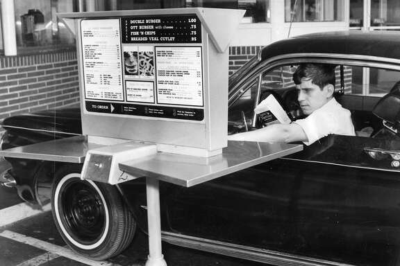 Aug. 7, 1967: A driver gets ready to order at Ott's Drive-in, a Fisherman's Wharf restaurant that was the first in the city to use an automated drive-through.