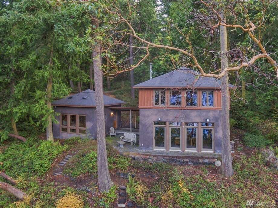 "The home at 6965 Cape George Rd. is about 7 miles southwest of the Port Townsend town center, but it truly feels like a world away. The listing information describes the home as a ""gorgeous jewel box in a retreat-like setting.""You can see the full listing here. Photo: Listing Courtesy Michelle Sandoval, Windermere R.E. Port Townsend"