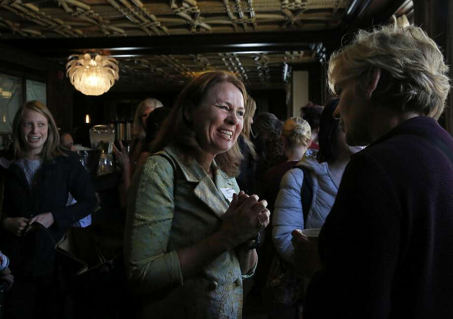 Leslie Darwin O'Brien (left) talks with former Michigan Gov. Jennifer Granholm during a gathering of women in politics organized by Emerge America, featuring Granholm as the keynote speaker. Photo: Leah Millis, The Chronicle