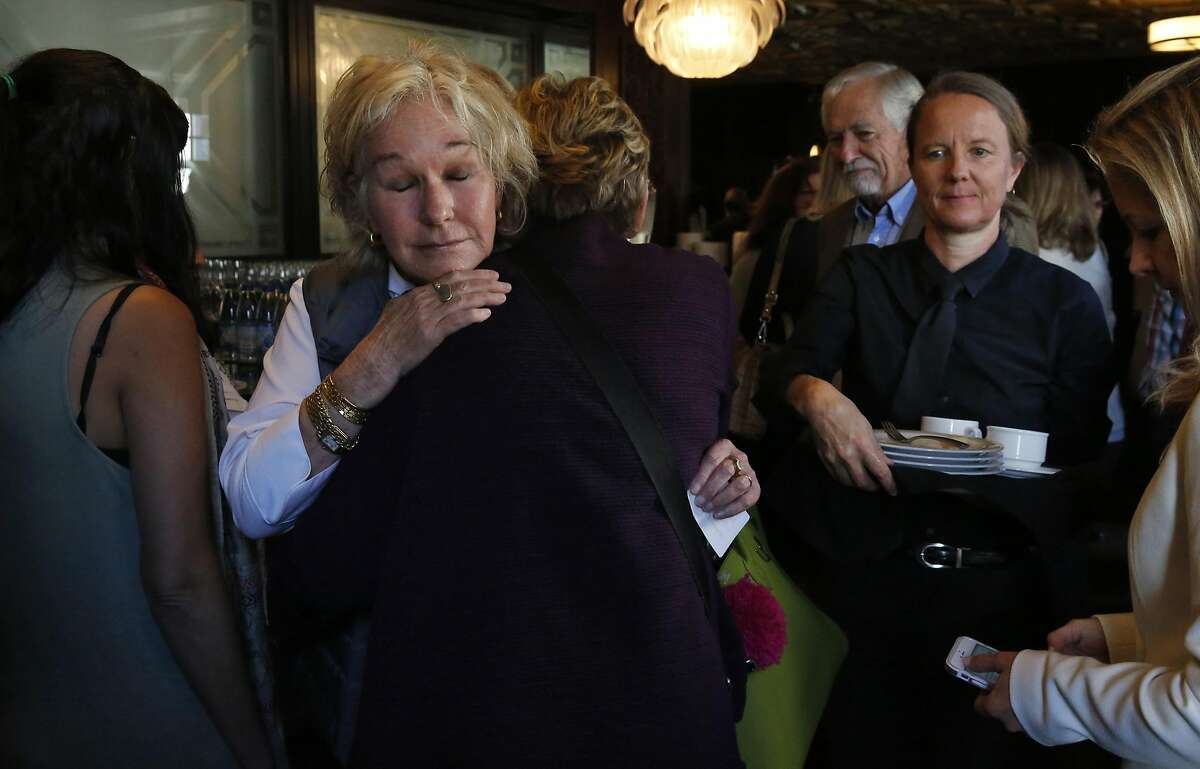 Susie Tompkins Buell, left, hugs former Governor of Michigan Jennifer Granholm during a gathering of women in politics organized by Emerge America, featuring Granholm as the keynote speaker Nov. 16, 2016 in San Francisco, Calif.
