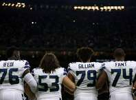 Germain Ifedi, Joey Hunt, Garry Gilliam and George Fant hold arms during the national anthem before the Seahawks' game against the New Orleans Saints at the Mercedes-Benz Superdome on October 30, 2016 in New Orleans, Louisiana.  (Photo by Jonathan Bachman/Getty Images)