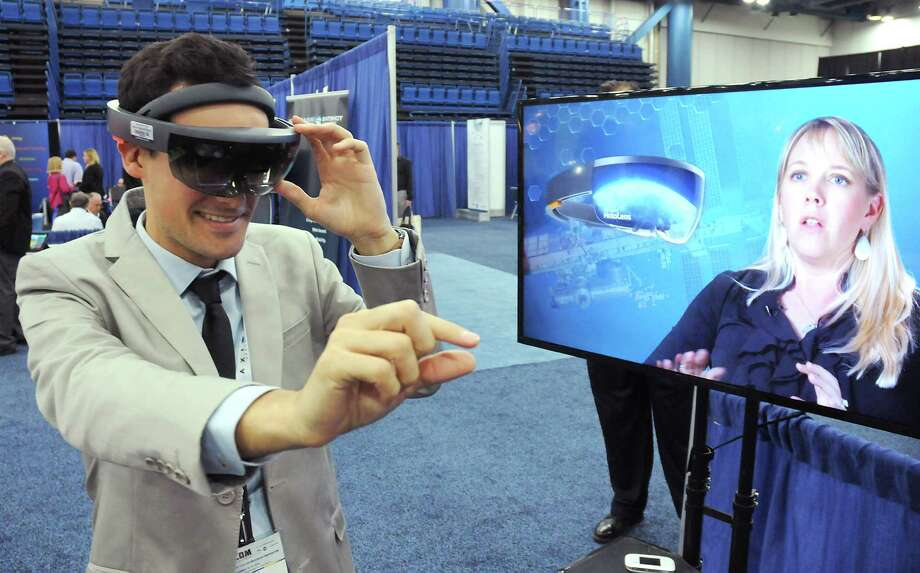Robin Faideau from the French Office for Science and Technology tries out virtual reality goggles from Aexa at SpaceCom at the George R. Brown Convention Center Wednesday  Nov. 16, 2016.(Dave Rossman photo) Photo: Dave Rossman, Freelance / Dave Rossman