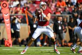 PALO ALTO, CA - NOVEMBER 05:  Keller Chryst #10 of the Stanford Cardinal drops back to pass against the Oregon State Beavers during the first quarter of their NCAA football game at Stanford Stadium on November 5, 2016 in Palo Alto, California.  (Photo by Thearon W. Henderson/Getty Images)
