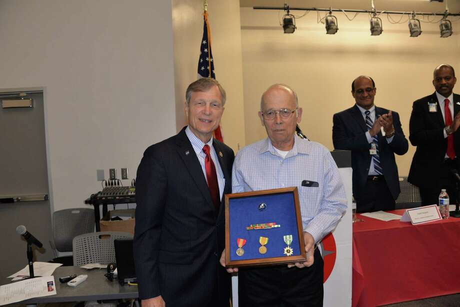 "Deer Park resident Walter Eggers, shown with U.S. Rep. Brian Babin (R-Woodville), was recently presented some medals for his Navy service in the 1960s in the Vietnam War. ""I just went over there did what I was supposed to do,"" says Eggers, 74,"
