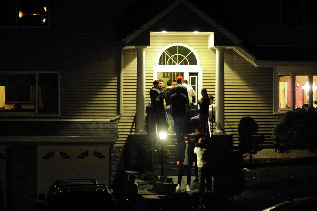 Family and friends gather at the Comunale home in Stamford on Wednesday to mourn the death of 26-year-old Joey Comunale.