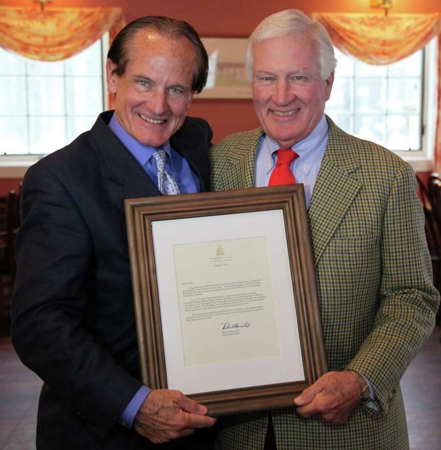 High Watch Recovery Center President and CEO Matt Walton, left, and Tony Rice, president of the board of directors, hold a declaration signed by Senator Richard Blumenthal congratulating High Watch on its new Treatment Living Center facility in Kent. Photo: Courtesy Of High Watch Recovery Center / The News-Times Contributed