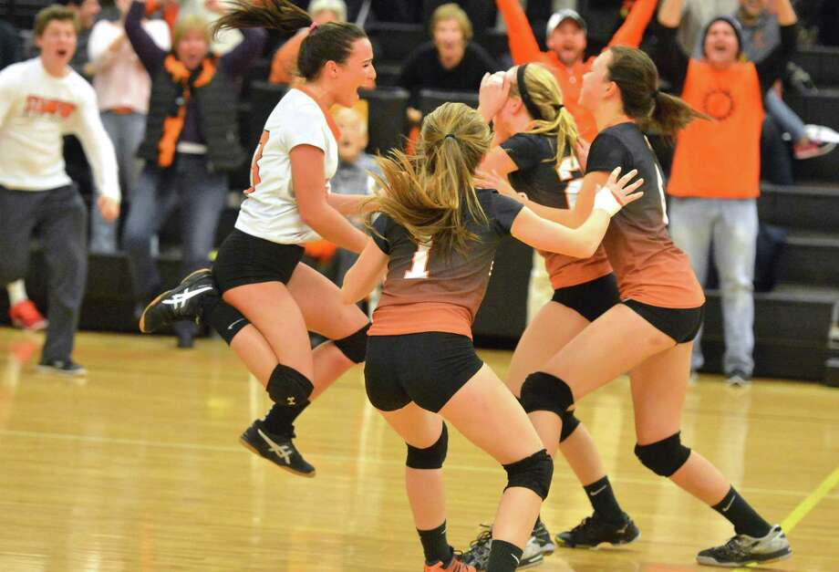 The Stamford girls volleyball celebrates after sweeping Amity in CIAC Class LL state semifinals on Wednesday night in Trumbull. Photo: Alex Von Kleydorff / Hearst Connecticut Media / Connecticut Post