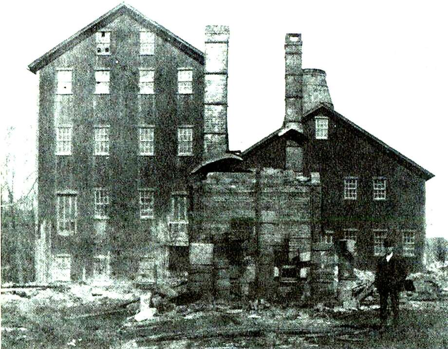 """The New Milford Pottery Company enjoyed a brief run in existence from the late 1880s until 1904 at its site next to the railroad bridge on the east side of the Housatonic River. If you have a """"Way Back When"""" photo you'd like to share, contact Deborah Rose at drose@newmilford.com or 860-355-7324. Photo: Courtesy Of """"Howard Peck's New Milford' / The News-Times Contributed"""
