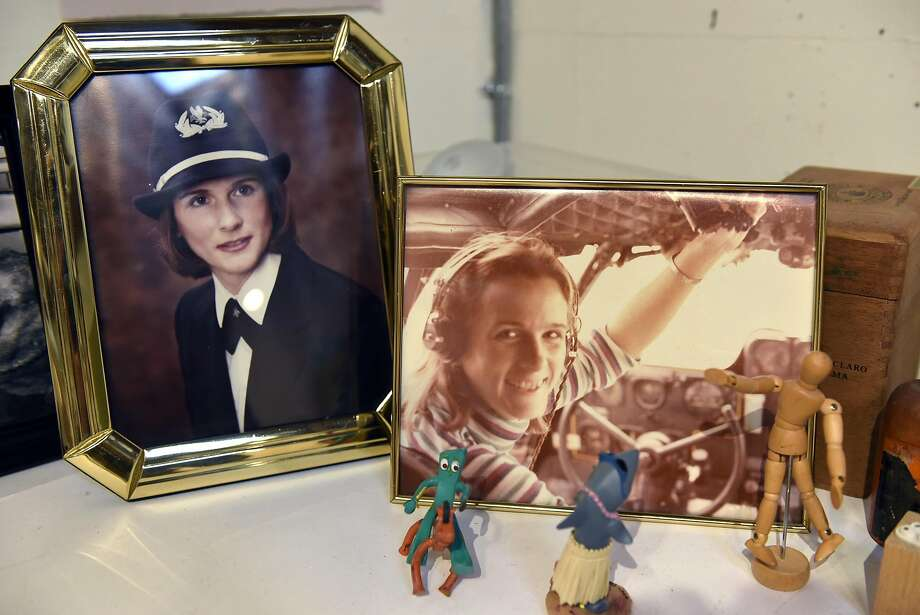 Pictures of Louise Victor from her former life as an American Airlines pilot are seen in her studio inside the Industrial Center Building in Sausalito. Photo: Michael Short, Special To The Chronicle