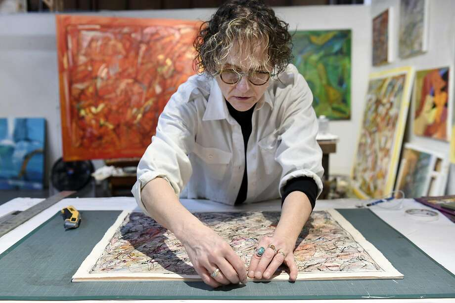 Louise Victor works on matting drawings on foam core in her studio inside the Industrial Center Building in Sausalito, CA Wednesday, November 16, 2016. Photo: Michael Short, Special To The Chronicle